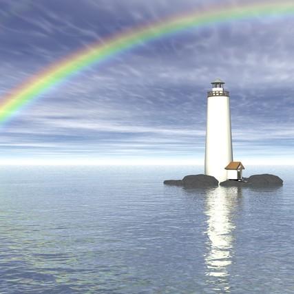 faro enmedio del mar en calma con arco iris